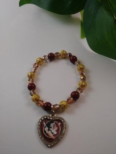 7 inch Stretch bracelet with charm. Hippie Bracelets, Beaded Bracelets, Football Bracelet, Seminole Florida, Handmade Items, Handmade Gifts, Stretch Bracelets, Hippie Boho, Jewelery