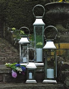 Stainless Steel Station Lanterns I would love to hang these at different heights in a single row as an accent to my entry way!