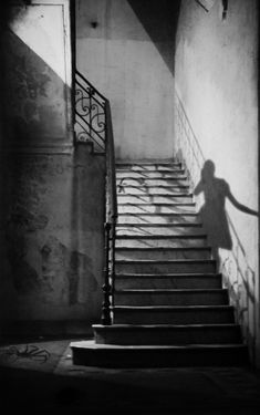 shadow | ghost ascending the stairs | brilliant black & white photography | afterlife | trick photography | ghosts |