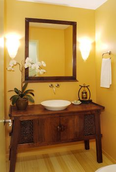 Use an Indonesian teak console cabinet to create a unique vanity.  Check out our Indonesian furniture collection at gadogado.com.