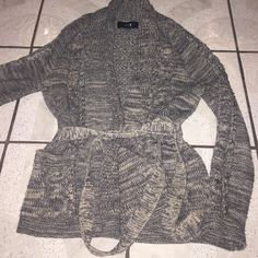 Forever 21 sweater Knitted sweater that ties up. So cute and only wore it once but I'm moving to Arizona so I don't really need this in the desert! Forever 21 Sweaters Cardigans