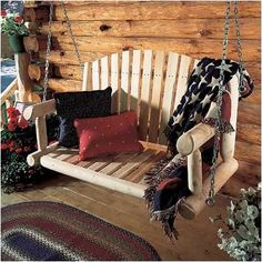 A rustic getaway deserves a rustic porch swing like this!
