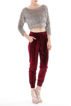 "Super luxurious dark wine colored velvet jogger pants with pockets. Material: 95% Polyester, 5% Spandex. Measurements: Inseam 9.5"" Length 31"". Imported"