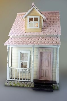 Exterior by jenSpec, via Flickr looks like cut down tongue depressors used for the roof shingles