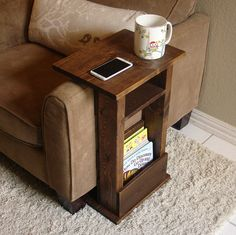 Handcrafted tray table stand with storage pocket. The perfect addition to a sofa chair in any home, apartment, condo, or man cave. It has been sanded down, then stained and sealed with a dark walnut finish. The stand is free standing and can be used anywhere around the house. Non-marking,