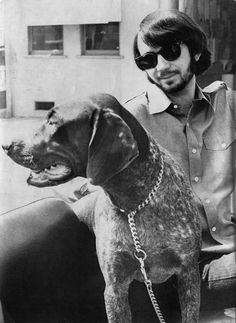 Mike Nesmith with a dog.