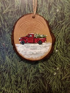 Wood slice Christmas ornament red truck in snow hand-painted Approx. 3 inches drilled hole with twine for hanging Beautiful sliced wood perfect for a rustic feeling hand-painted antique truck carrying a Christmas tree in the snow ornament. Willing to make multiples/message for