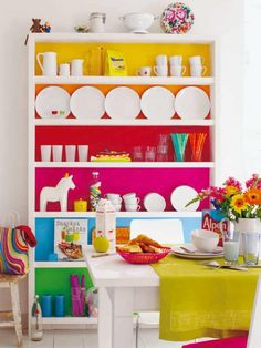 Rainbow: The bright rainbow hues that back this otherwise white bookcase turns this room into the most fun living room, like, ever.great idea for a kid's room. Oppa Design, Sweet Home, Diy Casa, Home And Deco, Diy Storage, Storage Ideas, Interiores Design, Painted Furniture, Colorful Furniture