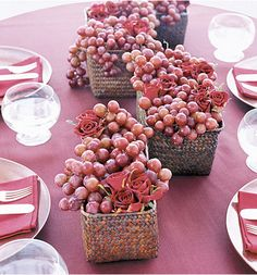 Friend suggested that you use green and purple grapes as part of your table decor. Would be pretty on burlap and would match your color scheme.