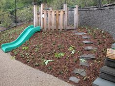 May 2004: Embankment slide with timber platform, groundcover planting and stone steps at Wellesley College Child Study Center.