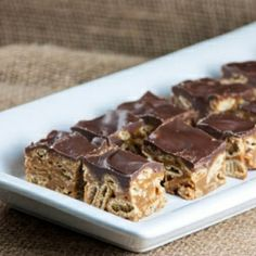 Addictive peanut butter crispy squares topped with chocolate. Gluten and dairy-free.
