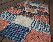 Homespun Red Country Primitive Rag Quilt Table Runner Button Adorned. $36.95, via Etsy.
