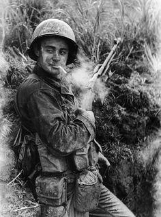 A Marine with a Browning Automatic Rifle taking a smoke break on Okinawa.