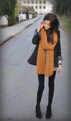 Big colored scarf with dark, muted outfit.