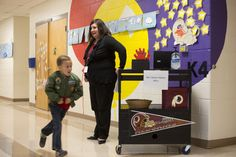 Olney Elementary principal wheels while she works in school - The Washington Post