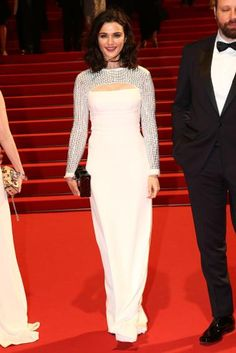 Whether black or white, Rachel Weisz still stuns. First, in a black Narciso Rodriguez jumpsuit and now in a white Louis Vuitton custom gown, which takes inspiration from the Fall 2015 collection.