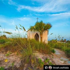 Have you ever visited the Chapel on the Dunes? Tag a friend you'd take here.  #portaransas #portaransastex  Repost @tirzah.oohlala  Beautiful Church!   This historic chapel on the dunes in Port Aransas was built for Poet Laureate of Texas Aline Carter in the 1930s. Frescoes depicting the history of Christianity cover the ceiling and walls of the chapel. The little chapel sits in the sand dunes 26-feet above the sea.  Photographer: Stephen Pituch