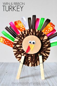 This yarn and ribbon Thanksgiving turkey craft is super cute and makes a perfect decoration for the holiday. Fun turkey craft for kids, Thanksgiving kids craft and fall kids craft.