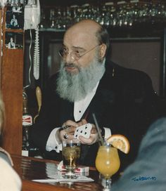 Magician Eugene Burger, Born in 1939. Reputed for his close-up skills and his work in mentalism and bizarre magic. Working behind the bar at Illusions, Carmel, IN.