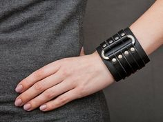 The black leather wide cuff bracelet with a metal oval element is must-have today. Our men women wristband adding and completing any image in fashion gothic outlook. This gothic jewelry bangle is a perfect best friend gift Leather Bracers, Leather Cuffs, Leather Jewelry, Black Leather Bracelet, Leather Ring, Metal Jewelry, Brown Leather, Rock Style, Rock Chic
