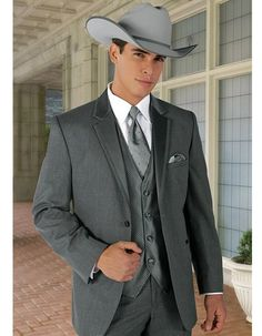 Classic Western Cowboy Tuxedo in Grey. All you need is to put on a hat, and throw on your bolo tie and you'll be good to go! Pants come 6 inches smaller than jacket, and can adjust 2 inches out or 4 inches in. #PromTuxedo #Tuxedo #GreyTuxedo #WeddingTuxedo #PromTux #WeddingTux #Tux #Wedding #Prom