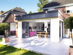 Adding a single-storey kitchen-diner extension to a detached house to create a useable family kitchen/dining/living space within an unusually shaped property Kitchen Extension Cost, House Extension Plans, House Extension Design, Extension Designs, Glass Extension, Roof Extension, Extension Ideas, Extension Costs, Flat Roof Design