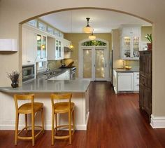 Knuth-Tate Residence I love the kitchen, and how the designers modernized the house while staying true to Victorian architecture & design