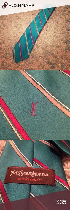 Yves Saint Laurent Men's Luxury Tie GUC. Yves Saint Laurent Luxury Tie. You can't go wrong with this luxurious tie. Very versatile colors. Those colors are teal, red, and tan. It is an overall good condition, with two pen dot sized spots. Would come out with a good scrub, I just do not want to mess the tie up at all. Retails $225. Check out my other listings for bundle deals! Yves Saint Laurent Accessories Ties