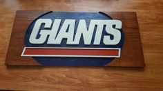 Hand routed new york giants logo from a solid oak plank. This was hand routed and then painted and sealed with 3 coates of urethane.