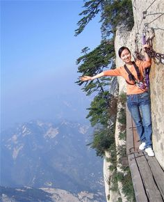 "Mount Hua in China is a picturesque mountain near the city of Huayin - but it's not just a pretty sight. The mountain is also home to the infamous ""plankwalk in the sky"", claimed to be the world's most dangerous hiking trail. This heart-stopping point-of-view footage shows just how dangerous the 2,154-metre climb is. The hiker, however, is remarkably unfazed."