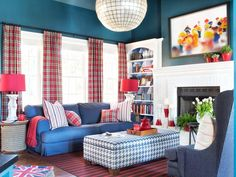This colorful family room features windows dressed with plaid draperies, a ceiling painted 60 percent lighter than the navy blue walls, a sofa with a machine-washable slipcover, end tables and table lamps, as well as an upholstered storage ottoman that keeps the boys' toys accessible yet out of sight.