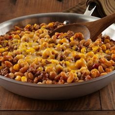 A ground turkey skillet recipe with beans, macaroni, Manwich, corn, green chilies and cheese for a quick flavorful entree with Southwestern flair
