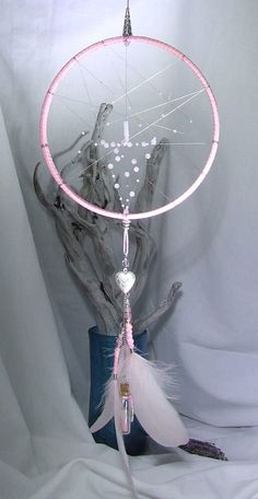 Check out this item in my Etsy shop https://www.etsy.com/uk/listing/267121884/dream-catcher-wall-hanging-rose-quartz