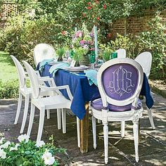 Spring for a Garden Party | Designer Jane Scott Hodges created this lunchtime scene by surrounding an antique cypress table with an unexpected pairing of antique and modern Louis XVI-style chairs, and then splashing the space with lush spring blooms and rich jewel tones. | SouthernLiving.com