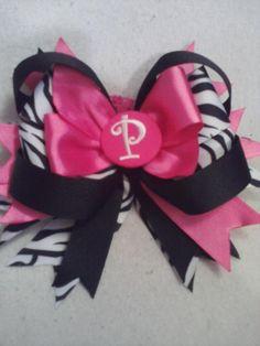 Hot pink, black/white zebra strip, black, and initial center