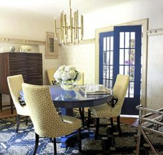 Modern style in a classic house. painted dining table, painted doors, and I really like that rug