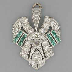 An Art Deco style emerald and diamond open-work geometric pendant Set with old-cut brilliant and triangular diamonds and calibré emeralds, diamonds approximately 3.0 carats total, pendant length 4.0cm.