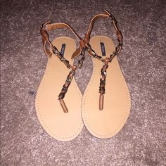 Forever 21 sandals Brand new sandals, with tags still attached to bottom. Light brown handles with a dark bronze color chain around the handles Forever 21 Shoes Sandals
