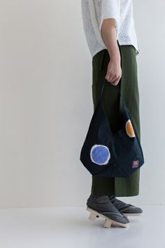 """The tote bag from the collaboration with Kyoto tie dye """"shibori"""" artisan. Each one is dyed by hand. $39.90"""