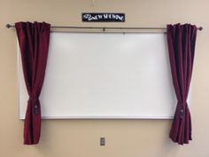 Curtains around a whiteboard. Perfect for a Drama classroom!!!