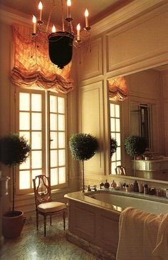wonderfulpalmettolife:    thefoodogatemyhomework:    Peachy panelling and sheer swag roman shade, beautiful marble, built-in mirror above the panel sided tub, graceful chandelier, twin topiaries, and antique lyre back chair in Karl Lagerfeld's bathroom. Oh so French and classically chic.    (via TumbleOn)