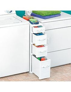drawers for the narrow space between the washer and dryer nice idea !! wow this is great for saving space, i hate when clothes fall inbetween there !