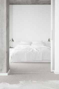 Bedroom white linen, flooring, walls grey lamps