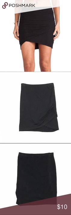 Black wrap bodycon mini skirt A super soft knit sculpts a stunning wrapped skirt that's ruched at the hips! This black wrap bodycon skirt by Charlotte russe features a banded elastic waist, and stretchy knit cotton with a ruched tulip slit that creates a flattering, asymmetrical bodycon fit. Hem is straight across in the back (pic 3). Great condition. Charlotte Russe Skirts Mini