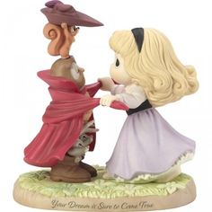 Add a special touch to your decor with the Disney Showcase Your Dream Come True Sleeping Beauty Figurine by Precious Moments. Crafted of hand-painted bisque porcelain, this figure showcases your favorite princess dancing with her forest friends.