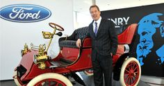 Bill Ford with Henry Ford's famous creation, the Model T.