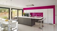 Stand-out kitchen design. A flash of colour can dramatically change the room. Consider contrasting pallets in your worktops, splash-backs and accessories to add a bright accent to your kitchen.