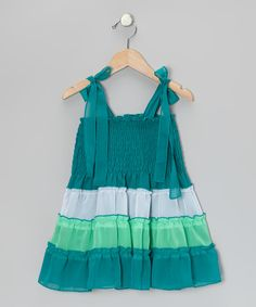 With a stretchy shirred bodice, adjustable straps and a colorful tiered skirt, this precious piece is primed for a day of comfort and play.100% polyesterMachine wash; tumble dryImported