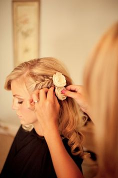 Side swept wedding hair with flowers. Eric likes when I just have to bangs pulled back from my face