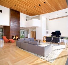 raised modern fireplace drywall surround living room contemporary with orange stainless steel armchairs and accent chairs